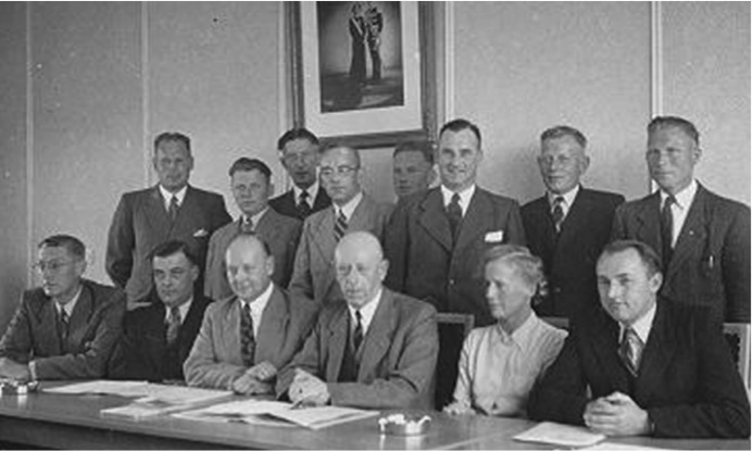The newly elected polder committee convening for its first meeting, 1951
